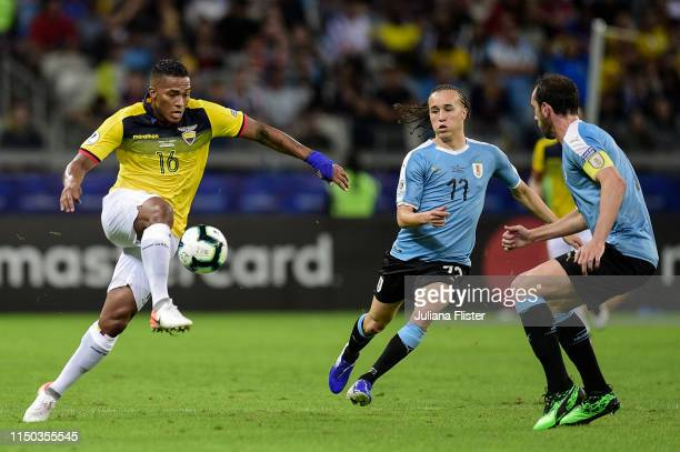 Diego Laxalt of Uruguay fights for the ball with Antonio Valencia of Ecuador during the Copa America Brazil 2019 group C match between Uruguay and...