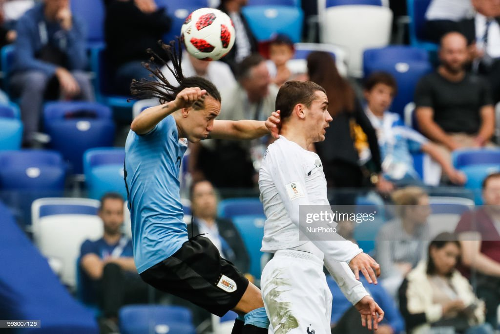 Diego Laxalt (L) of Uruguay national team and Antoine Griezmann of France national team vie for a header during the 2018 FIFA World Cup Russia Quarter Final match between Uruguay and France on July 6, 2018 at Nizhny Novgorod Stadium in Nizhny Novgorod, Russia.