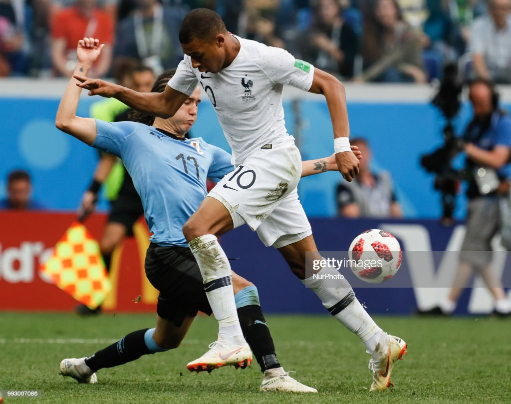 Diego Laxalt (L) of Uruguay national team and Kylian Mbappe of France national team vie for the ball during the 2018 FIFA World Cup Russia Quarter Final match between Uruguay and France on July 6, 2018 at Nizhny Novgorod Stadium in Nizhny Novgorod, Russia.