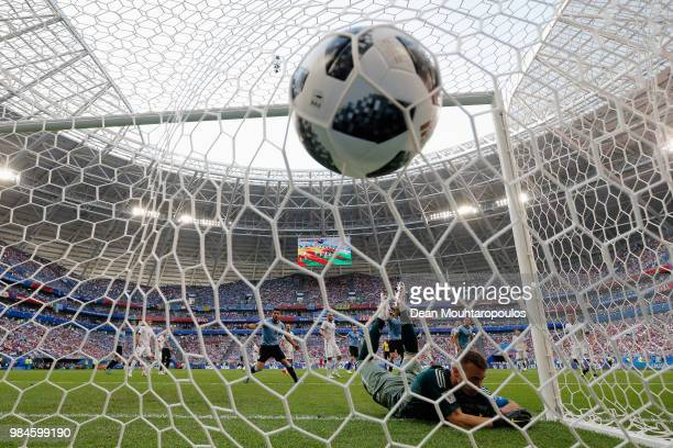 Diego Laxalt of Uruguay shoots and scores his team's second goal past Goalkeeper Igor Akinfeev of Russia during the 2018 FIFA World Cup Russia group...