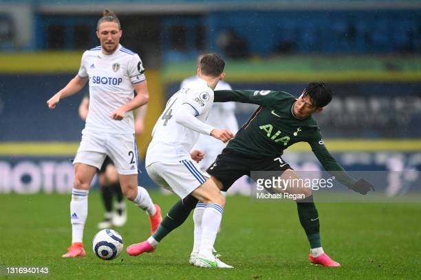 Diego Llorente of Leeds United battles for possession with Son Heung-Min of Tottenham Hotspur during the Premier League match between Leeds United...