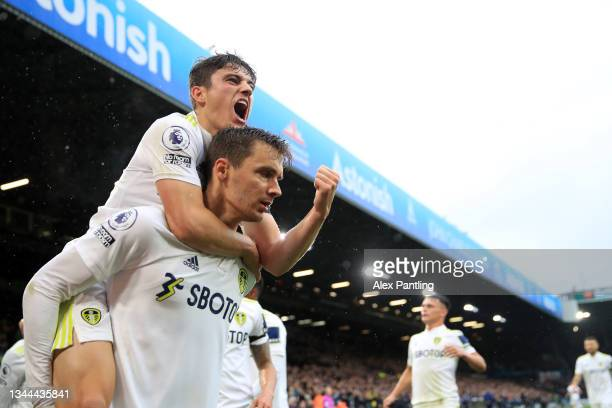 Diego Llorente of Leeds United celebrates with teammate Daniel James after scoring their side's first goal during the Premier League match between...