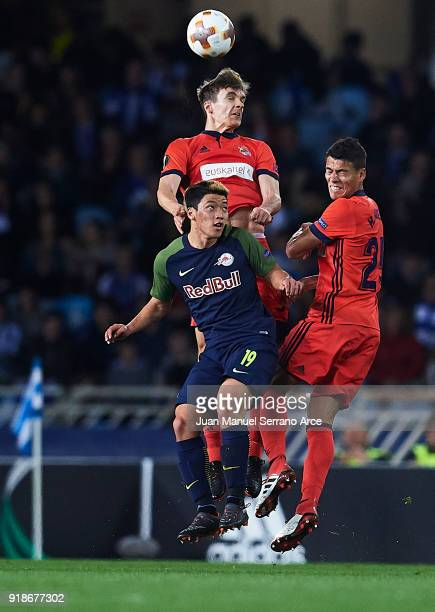 Diego Llorente of Real Sociedad and Hector Moreno of Real Sociedad competes for the ball with HeeChan Hwang of FC Red Bull Salzburg during UEFA...
