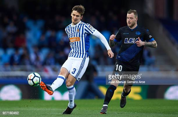 Diego Llorente of Real Sociedad being followed by John Guidetti of Deportivo Alaves during the La Liga match between Real Sociedad and Deportivo...