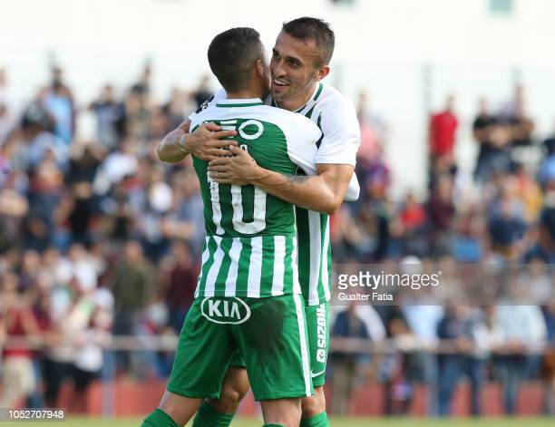 Diego Lopes of Rio Ave FC celebrates with teammate Joao Schmidt of Rio Ave FC after scoring a goal during the Portuguese Cup match between SCU...