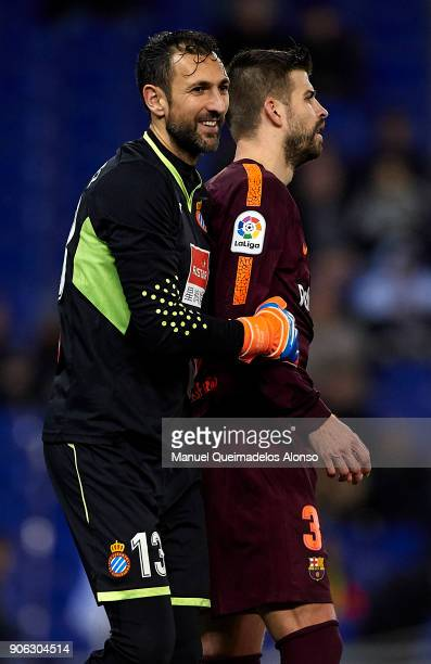 Diego Lopez of Espanyol reacts to Gerard Pique of Barcelona after the Copa Del Rey 1st leg match between RCD Espanyol and FC Barcelona at Nuevo...