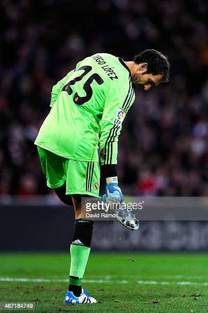 Diego Lopez of Real Madrid CF checks his boots during the La Liga match between Athletic Club and real Madrid CF at San Mames Stadium on February 2...