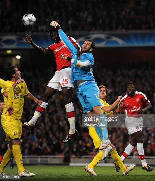 Diego Lopez of Villarreal punches the ball clear from Denilson of Arsenal