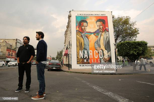 Diego Luna and Michael Pena pose during the photocall to unveil a mural of Netflix Narcos on October 30 2018 in Mexico City Mexico