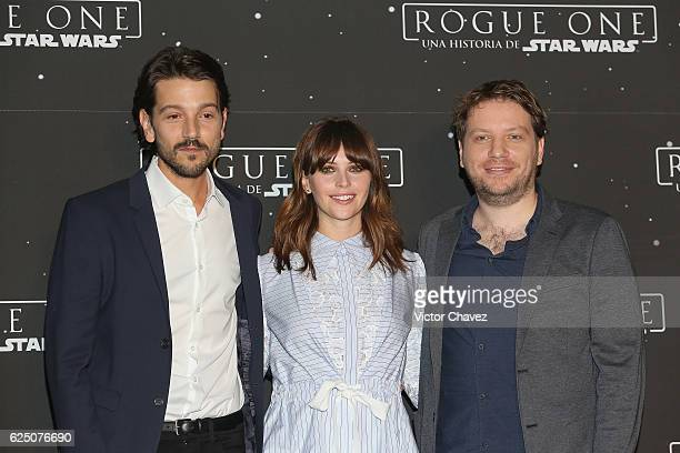 Diego Luna Felicity Jones and film director Gareth Edwards pose to photographers during a photocall to promote the film Rogue One A Star Wars Story...