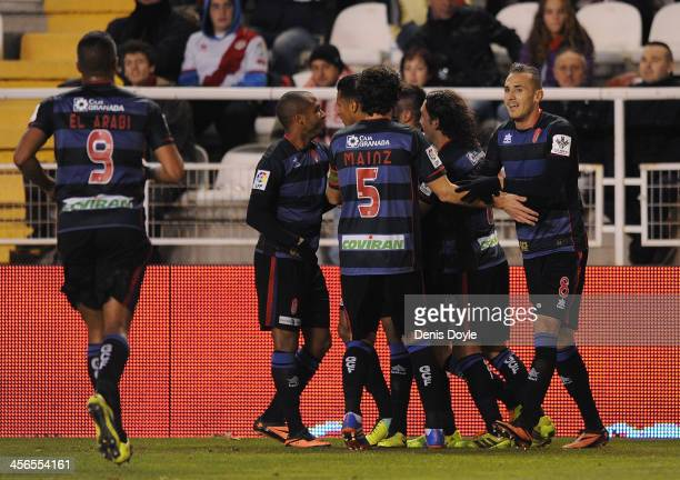 Diego Mainz Garcia Hassan Yebda and Granada CF players celebrate after the opening goal is scored by teammate Fran Rico during the La Liga match...