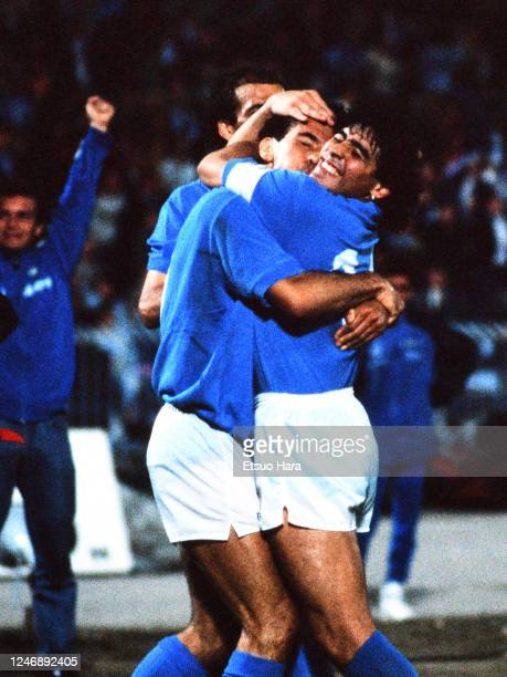 Diego Maradona and Careca of Napoli celebrate during the UEFA Cup semi final first leg between Napoli and Bayern Munich at the Stadio Sao Paulo on...