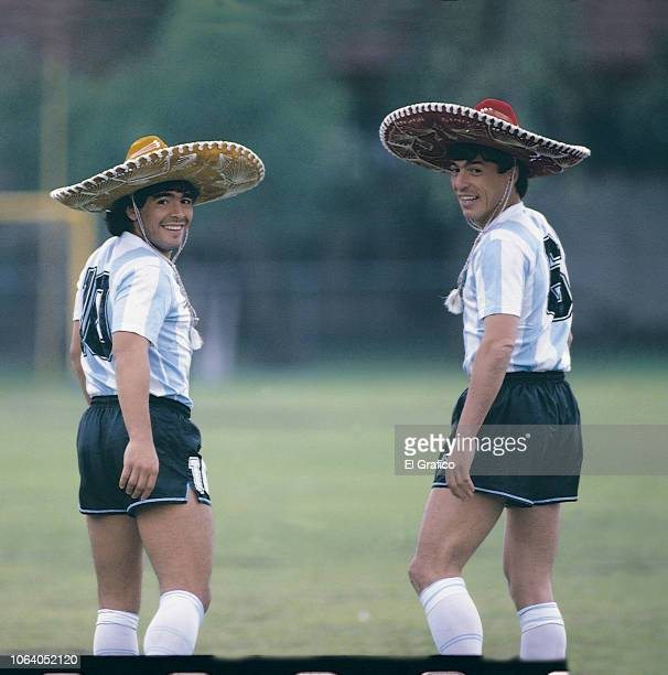 Diego Maradona and Daniel Passarella of Argentina pose with a sombrero ahead of the 1986 FIFA World Cup at Club America training camp on May, 1986 in...