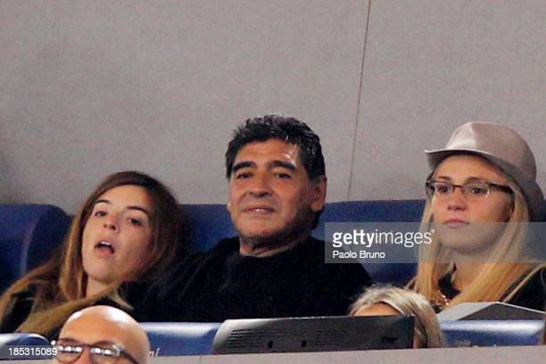 Diego Maradona and girlfriend Rocio Oliva attend the Serie A match between AS Roma and SSC Napoli at Stadio Olimpico on October 18 2013 in Rome Italy