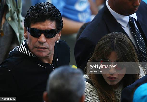 Diego Maradona and his daughter Giannina Maradona look on during the 2014 FIFA World Cup Brazil Group F match between Argentina and Iran at Estadio...
