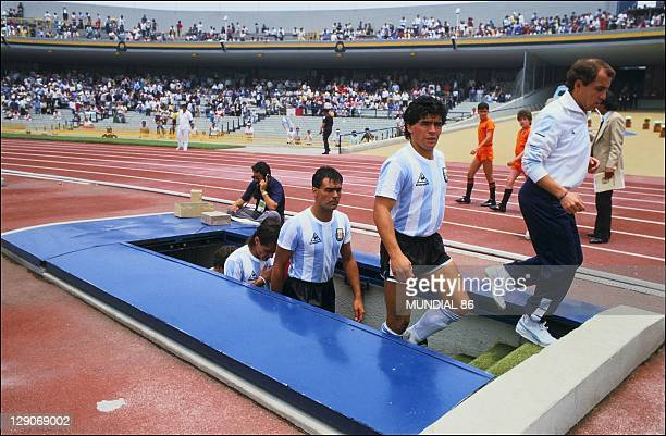 Diego Maradona and the Argentina's team arriving on the football field for the game against South Korea during the 1986 FIFA World Cup in Mexico on...