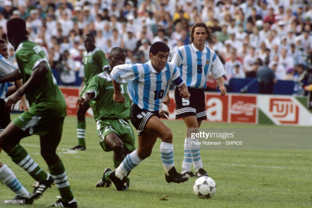 Diego Maradona, Argentina holds off the challenge from Nigeria's... News Photo - Getty Images
