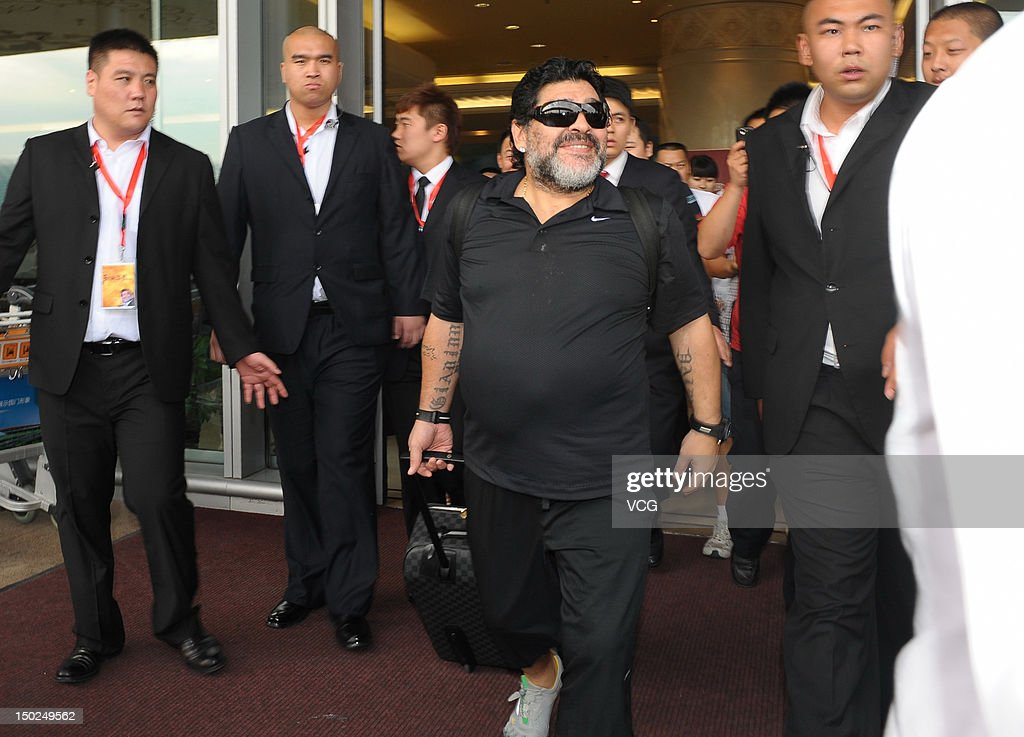 Diego Maradona arrives at Beijing Capital International Airport formally opening his series of activities on August 13, 2012 in Beijing, China.
