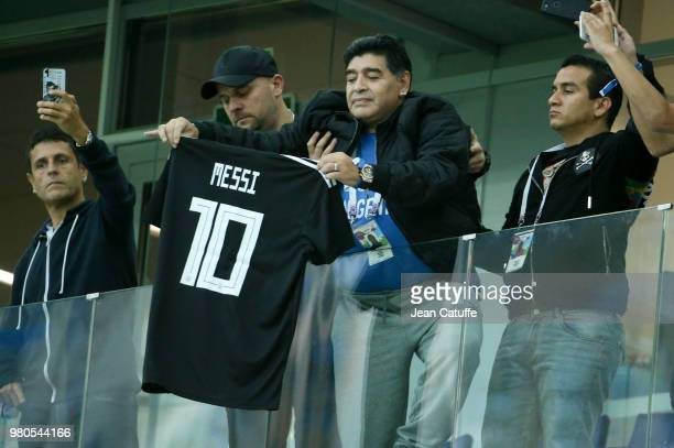 Diego Maradona brandishes the jersey of Lionel Messi of Argentina during the 2018 FIFA World Cup Russia group D match between Argentina and Croatia...