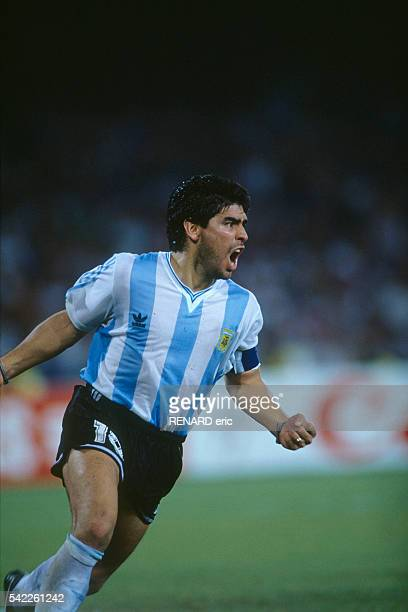 Diego Maradona celebrates victory over Italy during the semifinals of the 1990 FIFA World Cup
