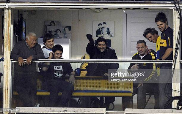 Diego Maradona cheers before a match between Boca Juniors and Corinthians as part of the first leg of the Libertadores Cup 2012 finals at Bombonera...