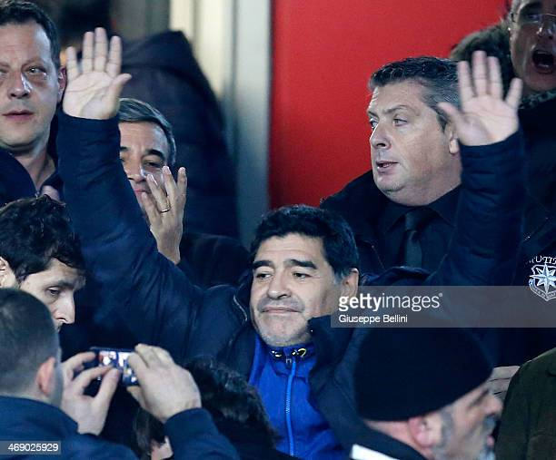 Diego Maradona cheers during the TIM Cup match between SSC Napoli and AS Roma at Stadio San Paolo on February 12 2014 in Naples Italy