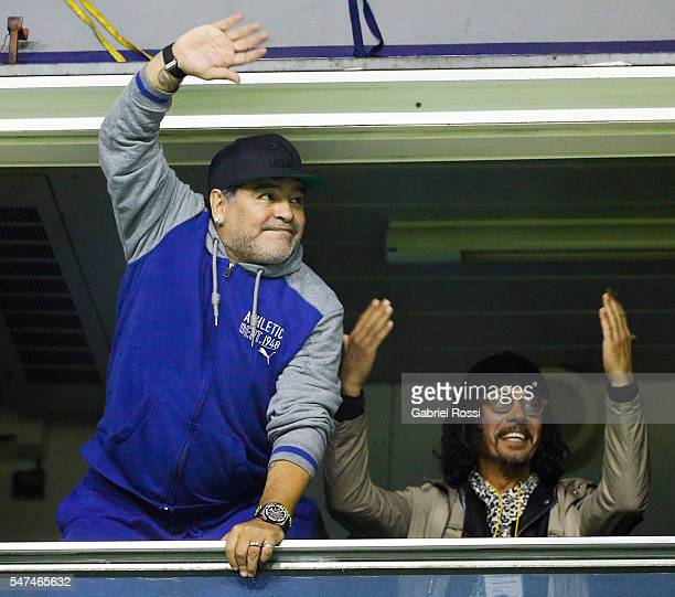 Diego Maradona cheers to the crowd before a second leg match between Boca Juniors and Independiente del Valle as part of semifinals of Copa...