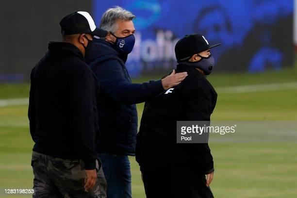 Diego Maradona coach of Gimnasia waves as he enters the field before a match between Gimnasia y Esgrima La Plata and Patronato as part of Copa Liga...