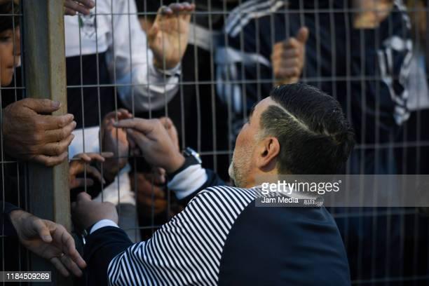 Diego Maradona coach of Gimnasia y Esgrima greets fans prior a match between Gimnasia y Esgrima La Plata and Arsenal as part of Superliga 2019/20 at...