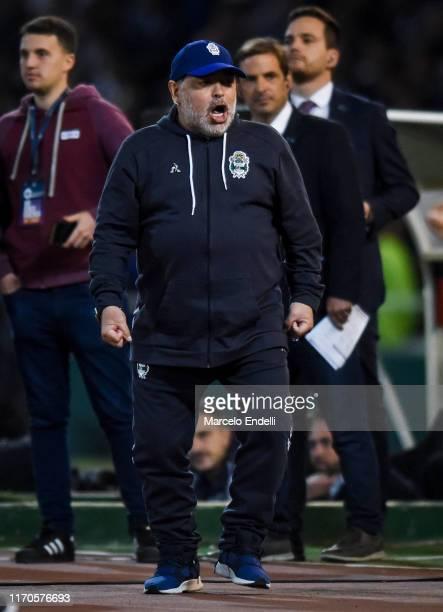 Diego Maradona coach of Gimnasia y Esgrima La Plata celebrates the first goal of his team during a match between Talleres and Gimnasia y Esgrima La...