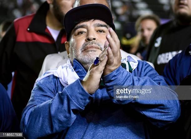 Diego Maradona coach of Gimnasia y Esgrima La Plata greets the fans after a match between Banfield and Gimnasia y Esgrima La Plata as part of...