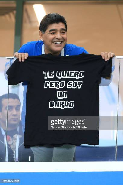 Diego Maradona displays a tshirt the words translate as 'I love you but I'm a fuck up' during the 2018 FIFA World Cup Russia Group D match between...