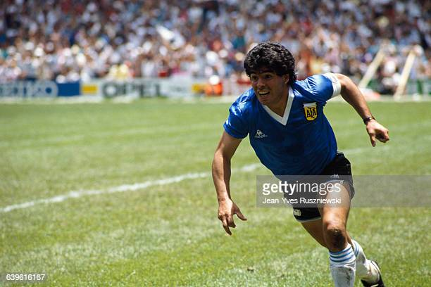 Diego Maradona from Argentina celebrates after scoring his second goal against England in a quarterfinal match of the 1986 FIFA World Cup.