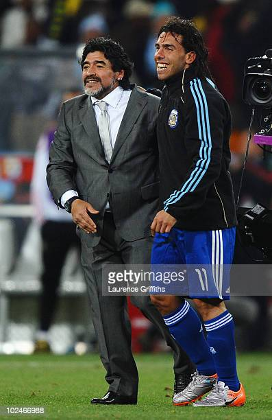Diego Maradona head coach of Argentina and Carlos Tevez celebrate victory and progress to the quarter finals in the 2010 FIFA World Cup South Africa...