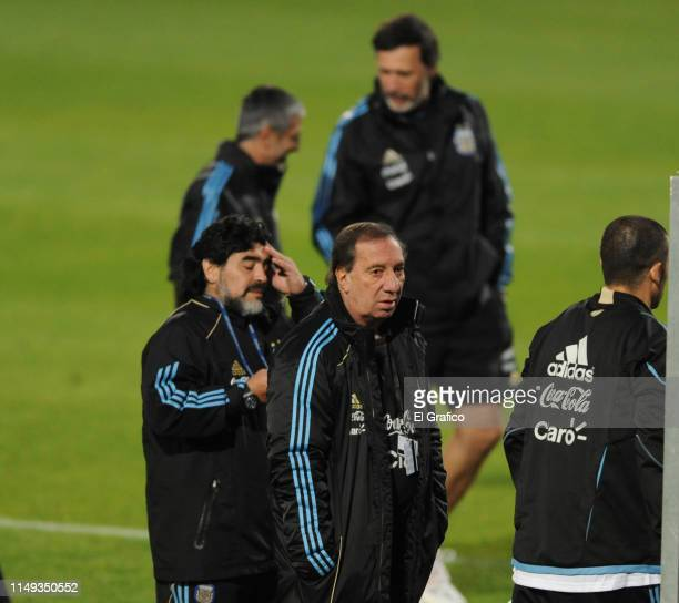 Diego Maradona head coach of Argentina and General Director of National Teams of Argentina Carlos Bilardo look on during a training session on June 6...