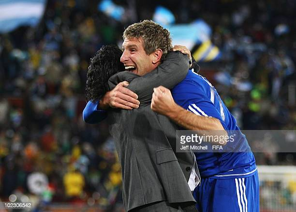 Diego Maradona head coach of Argentina celebrates a goal with Martin Palermo of Argentina during the 2010 FIFA World Cup South Africa Group B match...