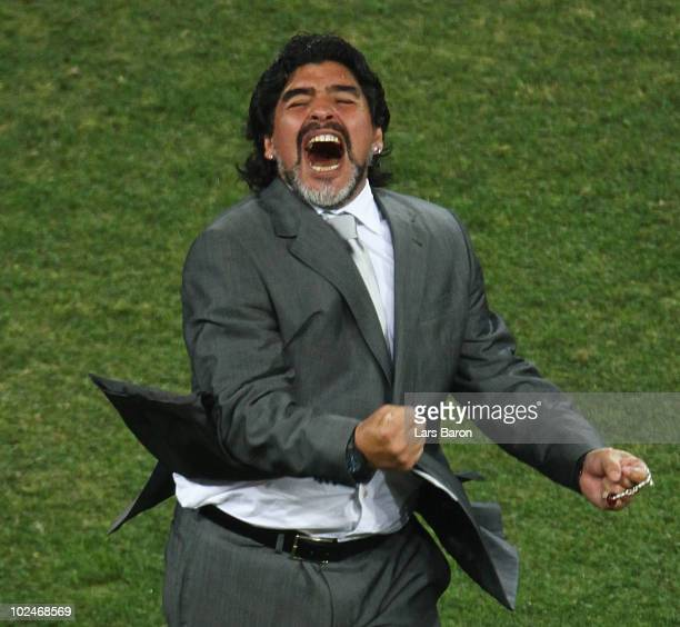 Diego Maradona head coach of Argentina celebrates the third goal scored by Carlos Tevez during the 2010 FIFA World Cup South Africa Round of Sixteen...