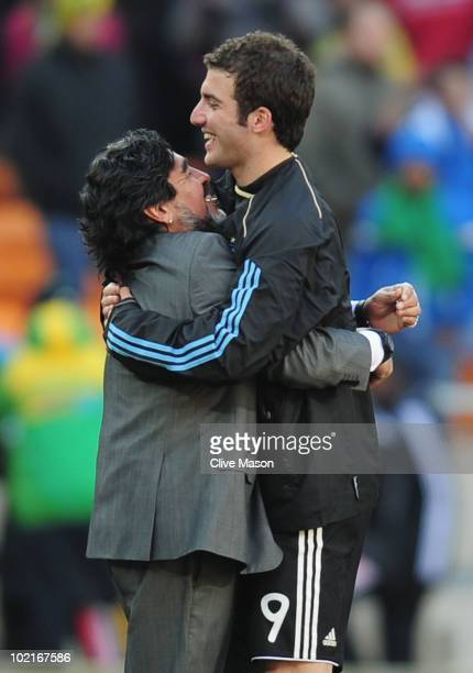 Diego Maradona head coach of Argentina celebrates victory with hat trick scorer Gonzalo Higuain of Argentina after the 2010 FIFA World Cup South...