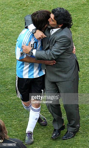 Diego Maradona head coach of Argentina celebrates victory with Lionel Messi of Argentina after the 2010 FIFA World Cup South Africa Group B match...