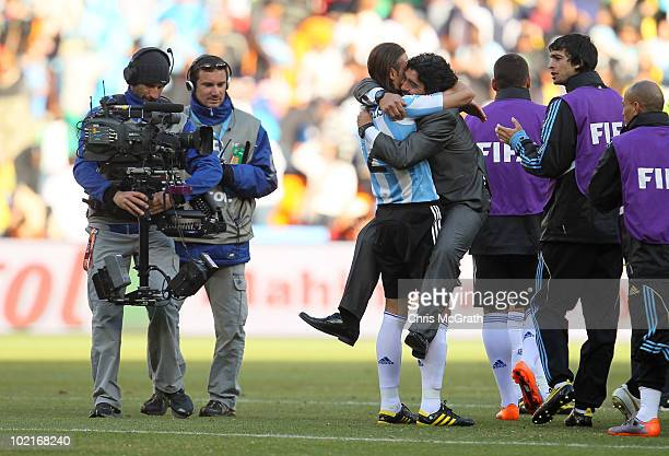 Diego Maradona head coach of Argentina celebrates victory with Martin Demichelis during the 2010 FIFA World Cup South Africa Group B match between...