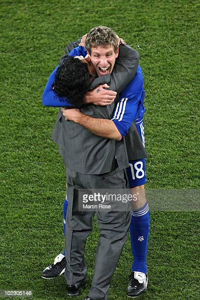 Diego Maradona head coach of Argentina celebrates victory with goalscorer Martin Palermo after the 2010 FIFA World Cup South Africa Group B match...