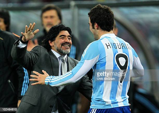 Diego Maradona head coach of Argentina celebrates with Gonzalo Higuain after he scores his side's second goal during the 2010 FIFA World Cup South...