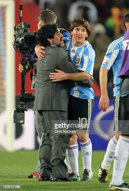 Diego Maradona head coach of Argentina congratulates Lionel Messi after victory in the 2010 FIFA World Cup South Africa Group B match between...