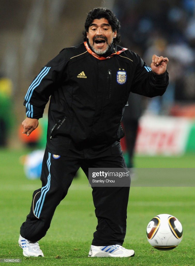Diego Maradona head coach of Argentina controls the ball during the warm up ahead of the 2010 FIFA World Cup South Africa Round of Sixteen match between Argentina and Mexico at Soccer City Stadium on June 27, 2010 in Johannesburg, South Africa.