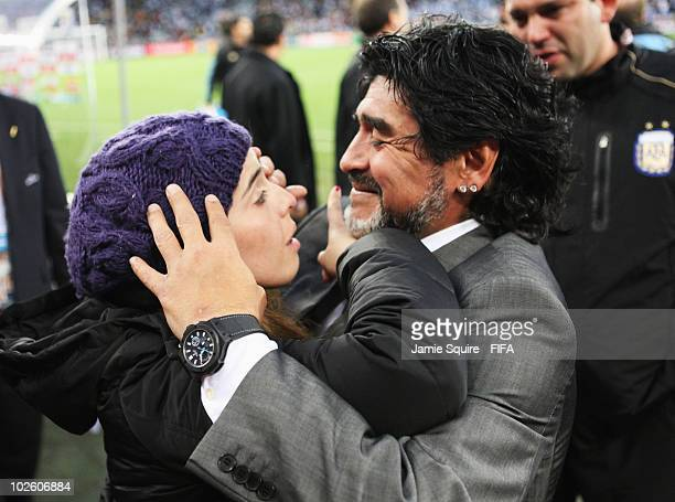Diego Maradona head coach of Argentina embraces his daughter Dalma after the 2010 FIFA World Cup South Africa Quarter Final match between Argentina...