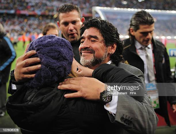 Diego Maradona head coach of Argentina is comforted by his daughter Dalma after the 2010 FIFA World Cup South Africa Quarter Final match between...