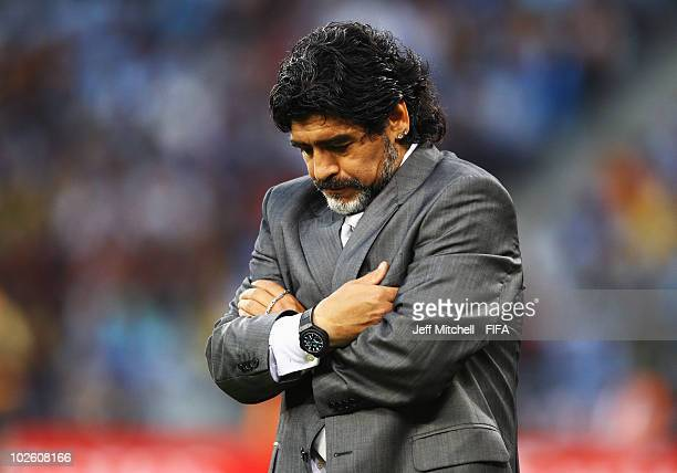 Diego Maradona head coach of Argentina looks down with dejection during the 2010 FIFA World Cup South Africa Quarter Final match between Argentina...
