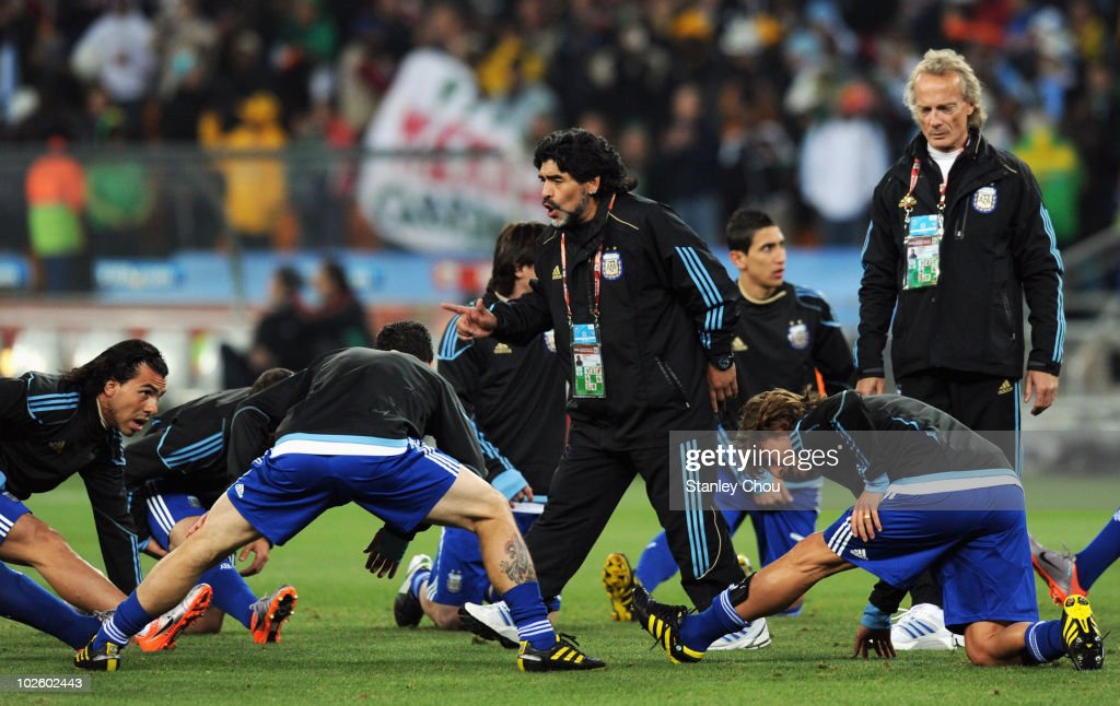 Diego Maradona head coach of Argentina speaks to his team during the warm up ahead of the 2010 FIFA World Cup South Africa Round of Sixteen match between Argentina and Mexico at Soccer City Stadium on June 27, 2010 in Johannesburg, South Africa.