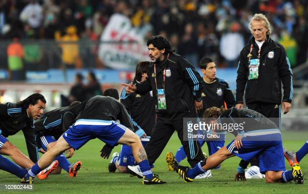 Diego Maradona head coach of Argentina speaks to his team during the warm up ahead of the 2010 FIFA World Cup South Africa Round of Sixteen match...