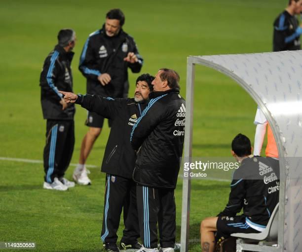 Diego Maradona head coach of Argentina talks with General Director of National Teams of Argentina Carlos Bilardo during a training session on June 6...